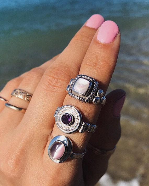 vintage/secondhand sterling silver rings with amethyst, pink mussel shell,& pink cat's eye