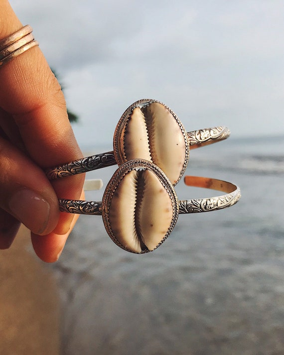 silver & gold cowrie shell cuff