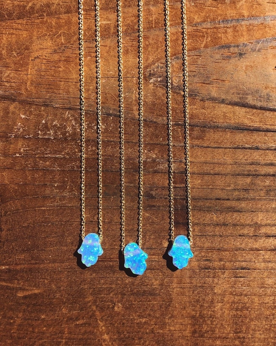 blue opal hamsa hand charm necklace on a dainty chain