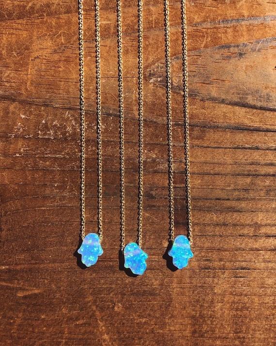 blue opal hamsa hand charm necklace on a dainty chain