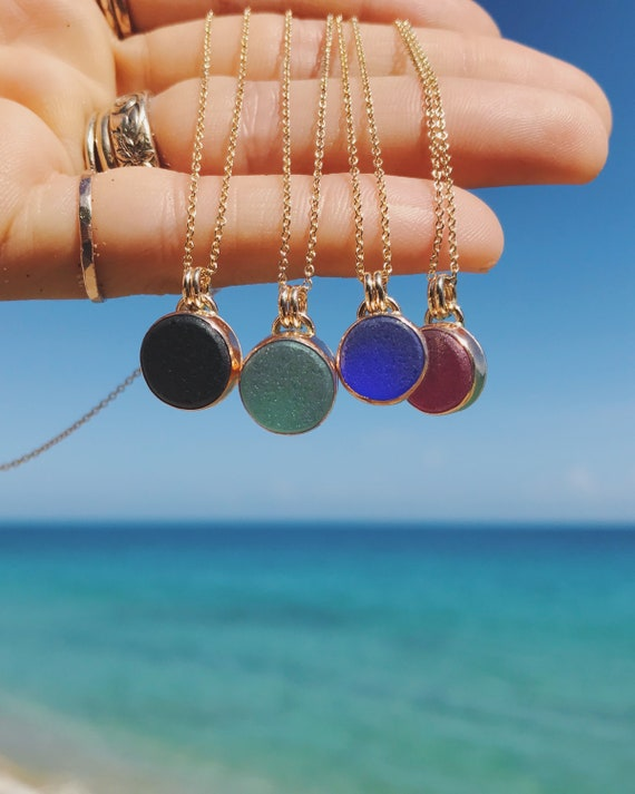 genuine black sea glass sun in gold
