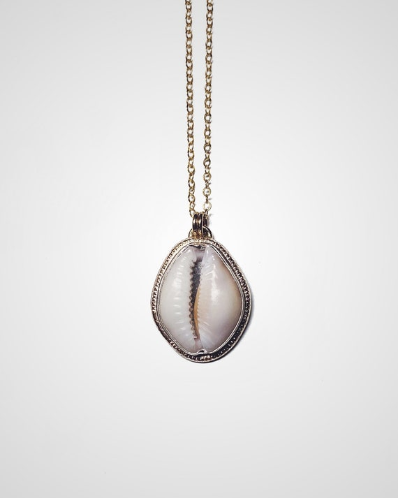 cowry shell sunshine necklace made with silver & gold