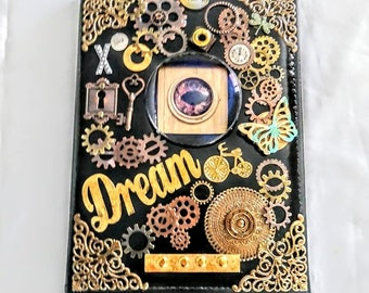 """Steampunk Photo Album Assemblage Mixed Media 9"""" by 6"""" Sleeves Eyes Accessories Designed by Kathy Stemke"""