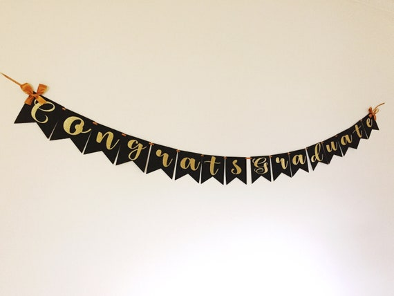 congratulations graduate banner in black and gold with bows