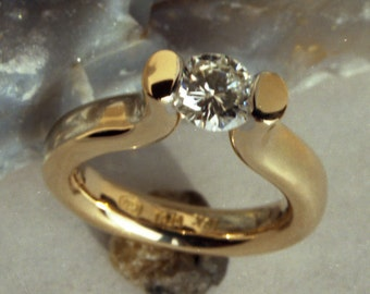 1/2 Carat Canadian Diamond Tension Set in Hand Made, Forged recycled 18k yellow gold Hammered Engagement Ring