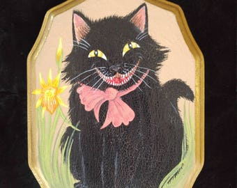 Laughing black cat amongst daffodils hand painted on a vintage wooden picture board