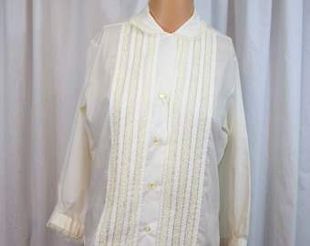 Vintage 1960s white long sleeve blouse with lace trim and peter pan collar by Lady Manhattan