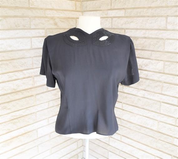 Vintage 1950s black crepe back button blouse with