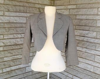 Vintage 1950s 1960s brown and white bracelet length sleeve lined bolero jacket