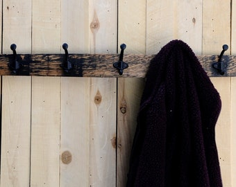 Wall coat rack with rustic double coat hooks on a repurposed whiskey barrel stave