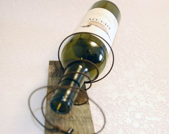 Wall wine rack made on a repurposed, reclaimed, upcycled wine barrel stave with rusty bed springs- ready to ship