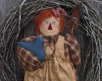 Raggedy Annie and her Bluebird