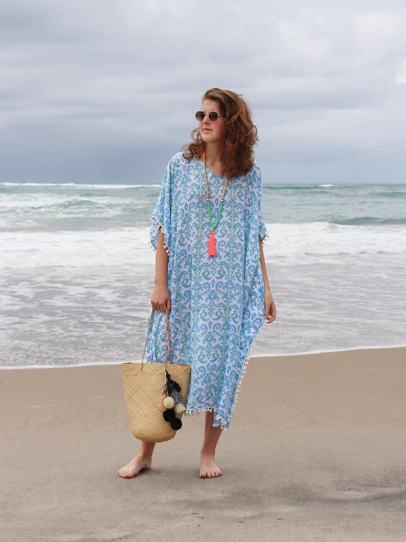 f37c4ba46ae5e Womans beach caftan dress with pom poms Blue and pale