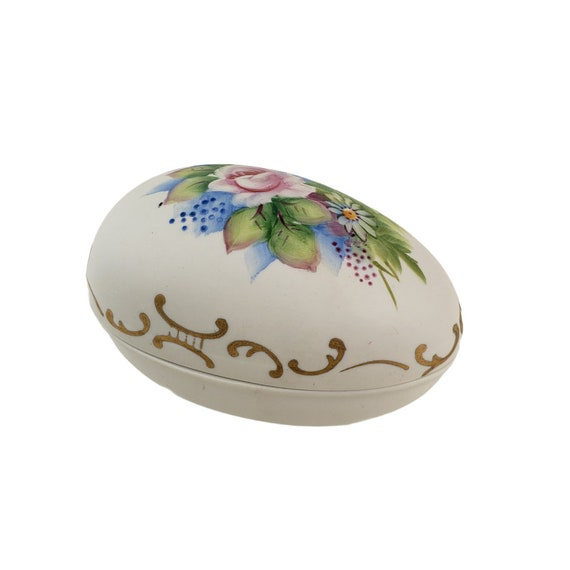 Vintage bisque bird on an egg trinket box
