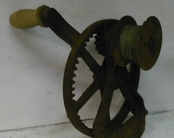 Antique cast iron wire roller