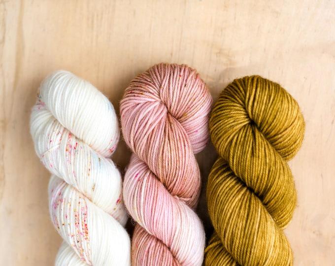 Fade Kit:  29 Bridges Merino DK - Gold/Pink/White