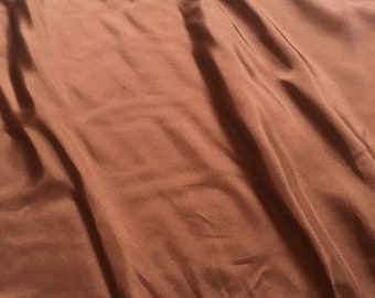 100% Silk in Brown
