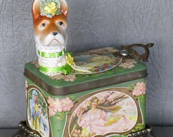 """Assemblage dog.  One of a kind named, """"Fleur."""" Terrier dog head, art nouveau style tin body, fancy feet, brass pull tail, lace & ribbon."""