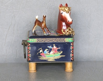 """Assemblage pony.  One of a kind, """"Taka and Tenshi.""""  Pony head with Asian Tea tin body, spool feet, brass embellishments and colt figurine."""