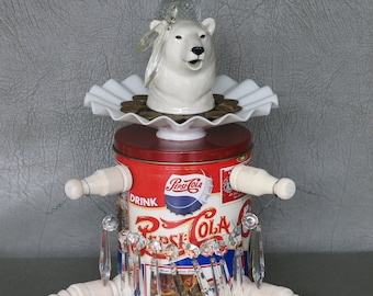 """One-of-a-kind assemblage polar bear, """"Izzy's Icicles.""""  Porcelain head, Pepsi tin body, peg legs, with crystal bowl & prisms, brass ashtray."""