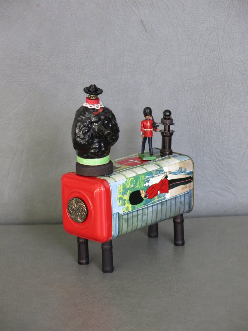 Assemblage poodle.  One of a kind. British Bobby. image 1