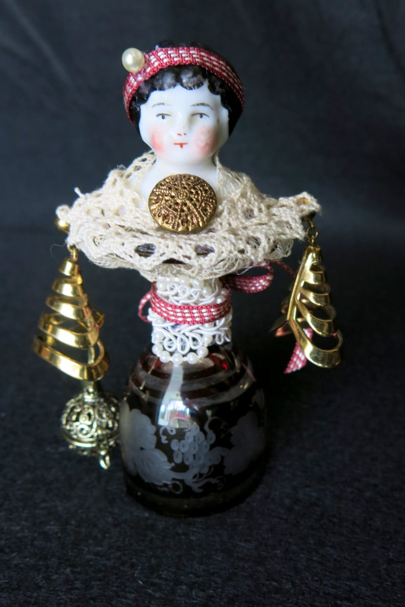 China assemblage doll.  Has cordial glass body earrings for image 0