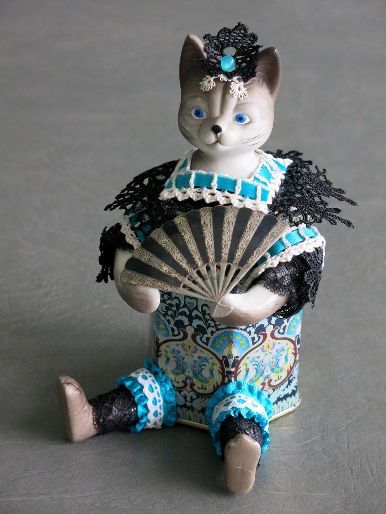 Assemblage cat.  Conchita.  Porcelain cat image 0
