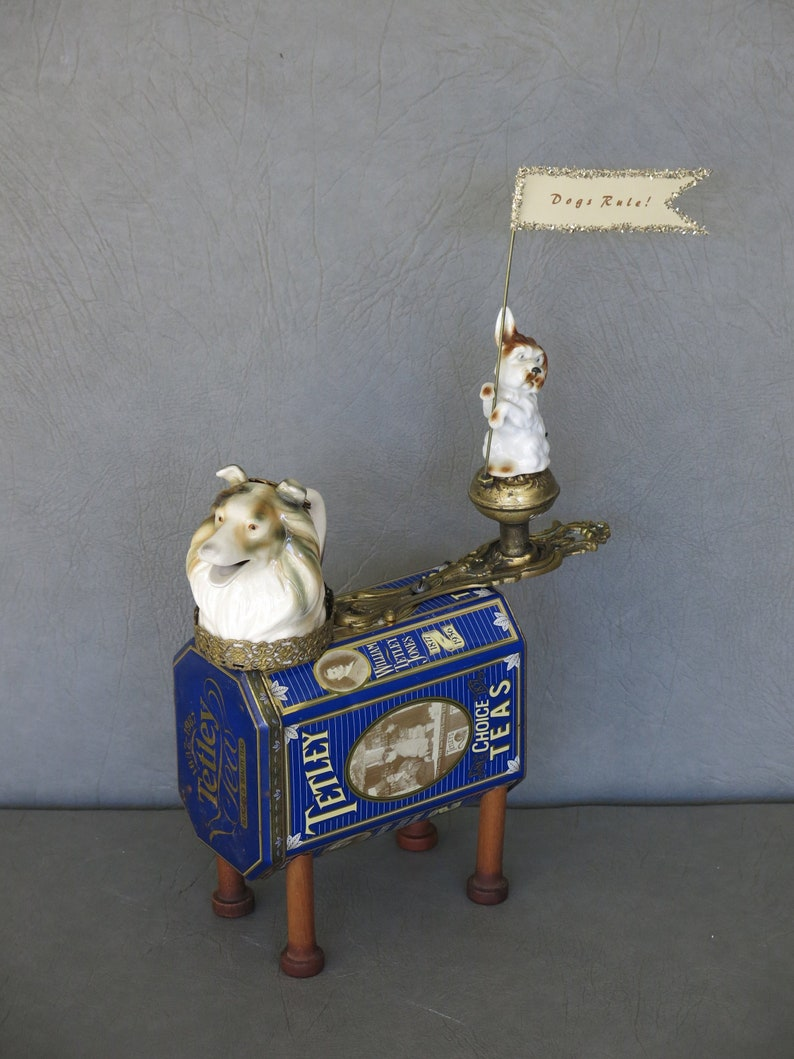 Parade dog whimsical assemblage sculpture.  Terrier dog is image 0