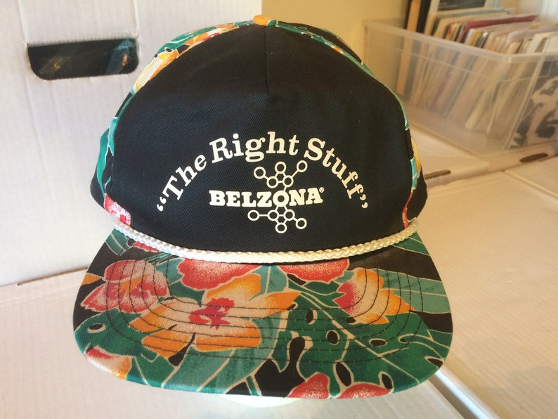 chemical materials company Vintage Baseball Cap black cap with green and orange tropical pattern Belzona The Right Stuff
