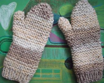 Warm winter mittens in beige shades