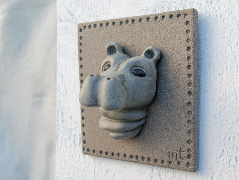 Portrait of a baby Hippo on a ceramic tile