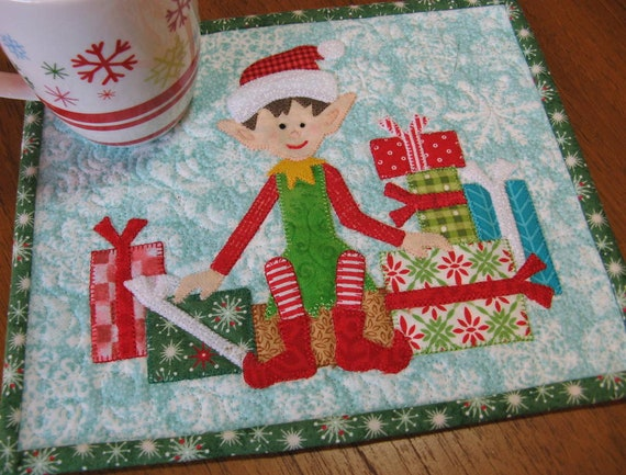 Wrapped and Ready is a cute Christmas elf with his presents mug rug quilt pattern