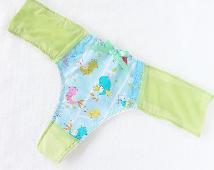 Green and blue thong 'Little Bird' with blue lace edging