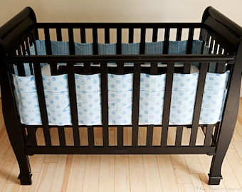 Unique Crib Bumpers that allow you to change the crib sheets with out removing the bumpers. Custom colors also available