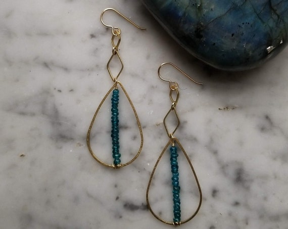 Apatite lined brass teardrops