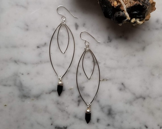 Sterling silver double marquise with faceted black onyx points