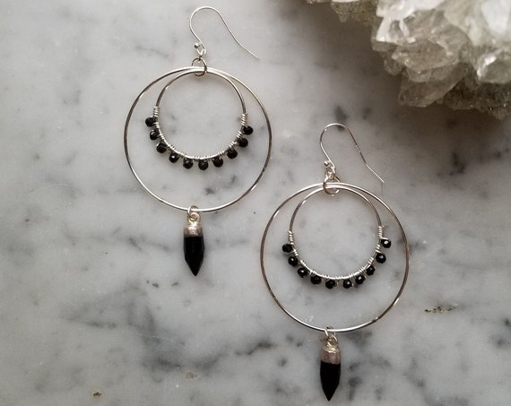 Black onyx wrapped sterling circles with silver topped black onyx point