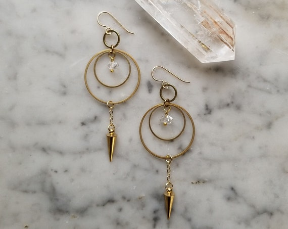 Herkimer diamonds on brass connected circles with pendulum spike hoops