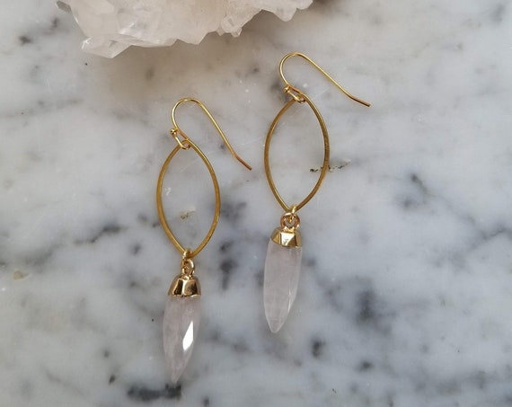 Brass marquise shape with faceted quartz crystal points