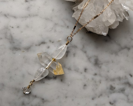 Quartz crystal flower totem necklace with herkimer diamond detail