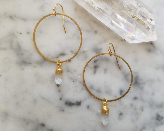 Brass circles with faceted quartz crystal points