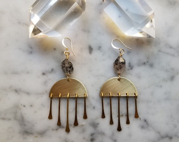 Herkimer diamonds with inclusions on brass half moons with brass fringe
