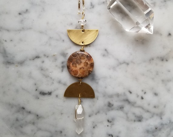 Brass moon phase necklace with fossilized coral and double quartz crystals