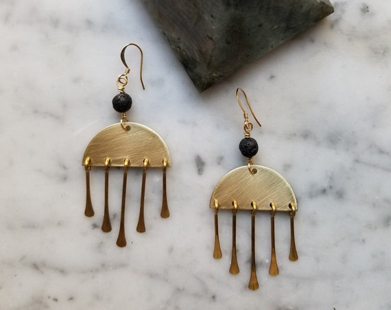 Lava stone on brass half moons with brass fringe