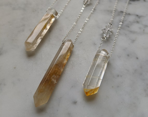Double terminated golden quartz crystal necklace with large herkimer diamond detail on sterling silver chain NSQ001