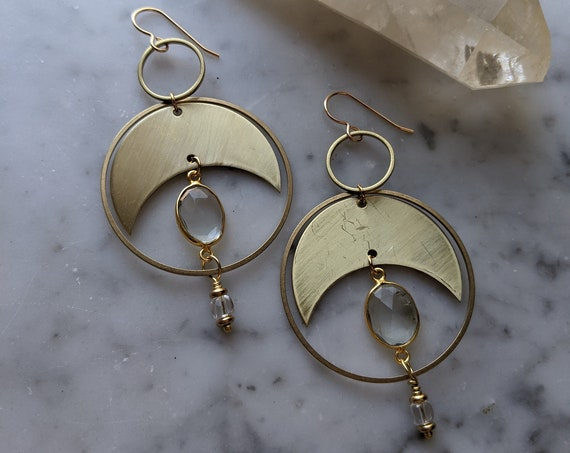 Faceted clear quartz ovals and brass crescent moon phase dangle earrings