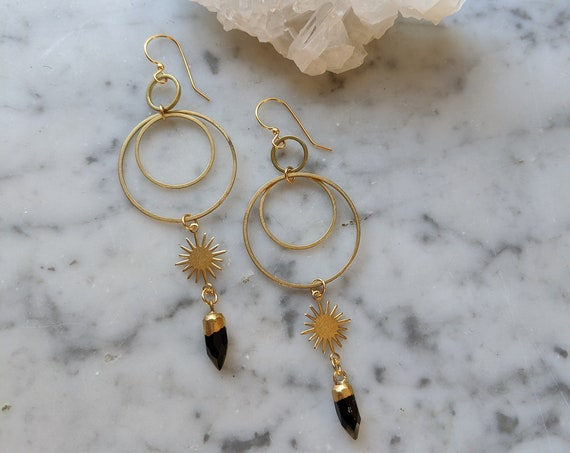 Brass sunburst earrings with concentric circles and black onyx points - EBO007