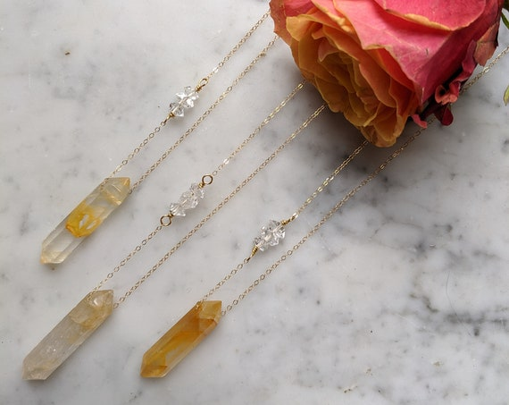 Double terminated golden quartz crystal necklace with large herkimer diamond detail on gold filled chain NGQ001