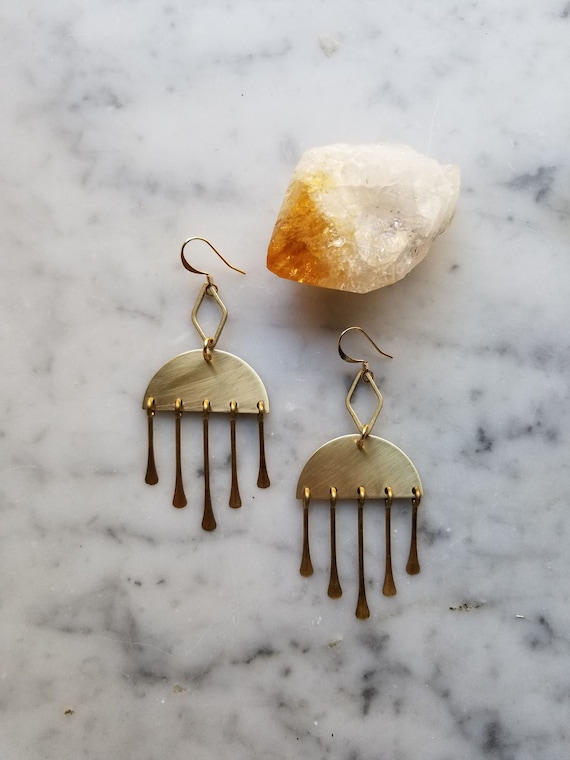 Brass diamond shape on brass half moons with brass fringe