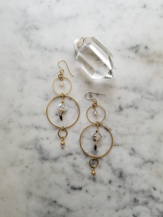 Herkimer diamonds on varying sizes of brass connected circles rings hoops electroplated